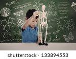asian boy learns biology  in a... | Shutterstock . vector #133894553