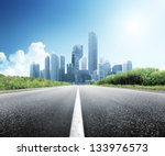 asphalt road and modern city | Shutterstock . vector #133976573