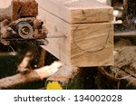 Small portable, bandsaw sawmill being used to cut a cedar log into dimension lumber in Oregon - stock photo