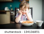 Offended little boy during eating  spaghetti at dinner - stock photo