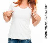 Girl's body in white t-shirt isolated - stock photo