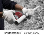 Worker Cutting Pvc Pipe In...