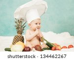 cute little baby chef eating...