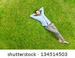 handsome man on the grass | Shutterstock . vector #134514503