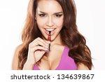 happy woman smoking e cigarette | Shutterstock . vector #134639867