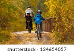 Family Cycling Outdoors  Fathe...