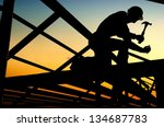 Builders are building a wooden house. - stock photo