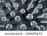 chrome screw on a blur black and white background - stock photo