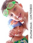 two happy kids with goggles on... | Shutterstock . vector #134703803