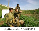 YUVAL, ISRAEL - MARCH 28: Israeli army soldiers (IDF) on a foot patrol along the Israeli border with Lebanon on March 28, 2000. - stock photo