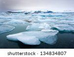Blue Icebergs Floating In The...