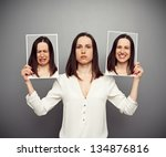 young woman hiding her emotions - stock photo