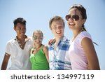 group of friends, looking at camera, smiling - stock photo