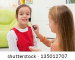happy little girl smiling while ... | Shutterstock . vector #135012707