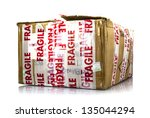 Cardboard box with fragile signs - stock photo