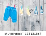 baby clothes hanging on the... | Shutterstock . vector #135131867