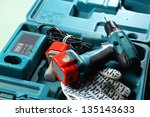 screwdriver and gloves in the... | Shutterstock . vector #135143633