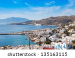 Top view of the town and the old port of Mykonos island at sunset. - stock photo