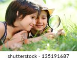 two boys with magnifying glass... | Shutterstock . vector #135191687