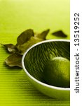 Small photo of Lime with kafir leaves on the green table