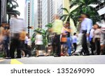 Unidentified businessmen crossing the street in Singapore. There are more than 7,000 multinational corporations from US States, Japan and Europe in Singapore - stock photo