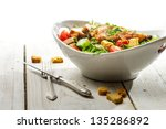 Fresh salad with chicken on white background - stock photo