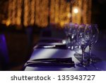 wine glasses set on a dinner... | Shutterstock . vector #135343727
