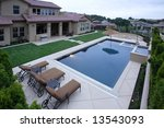 a pool with a waterfall in a... | Shutterstock . vector #13543093
