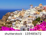 Beautiful classic view of Santorini Greece with flowers - stock photo