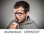 man with magnifying lens over... | Shutterstock . vector #135542147