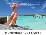 girl on the wooden jetty... | Shutterstock . vector #135572957