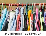 many clothes on clothes hanger | Shutterstock . vector #135595727