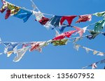 A group of colored shirts on a clothesline - stock photo