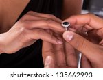 close up of male hand inserting ... | Shutterstock . vector #135662993