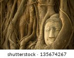 Buddha Head in the roots of the tree, Ayutthaya, Thailand. - stock photo