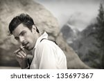 sexy hunky male model outdoors... | Shutterstock . vector #135697367