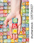 hand holding abc letters over... | Shutterstock . vector #135734327