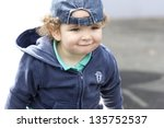 Portrait of little boy in hat, outdoor shot - stock photo