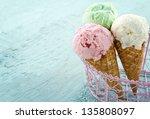 three ice cream cones on blue... | Shutterstock . vector #135808097