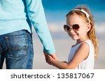 adorable little girl holding... | Shutterstock . vector #135817067
