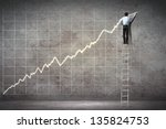businessman standing on ladder... | Shutterstock . vector #135824753