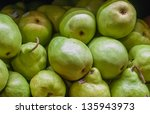 pears on display at farmers market - stock photo
