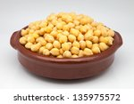 casserole of chick-peas cooked on white fund - stock photo