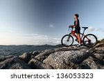 young athlete standing on top... | Shutterstock . vector #136053323