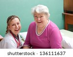 older patient and doctor are... | Shutterstock . vector #136111637