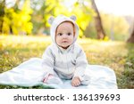 Stock photo cute caucasian baby boy in park looks at camera 136139693