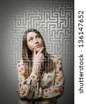 Young woman looking for the solution. - stock photo