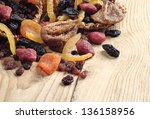 Dried fruits on a wooden background - stock photo