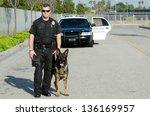 a k9 police officer standing... | Shutterstock . vector #136169957