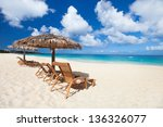 chairs and umbrellas on a... | Shutterstock . vector #136326077